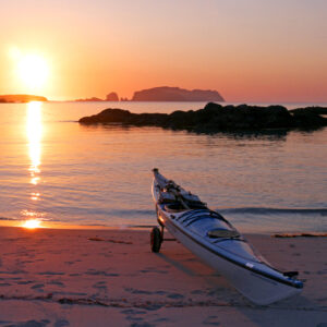 Sunset and sea kayak at Boasta bay Atlantic Ocean