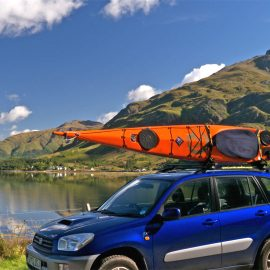 J Cradles kayak in transport