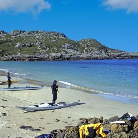 Sea kayakers on the beach Sea of Hebrides